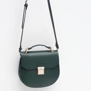 Zara oval crossbody purse with gold details